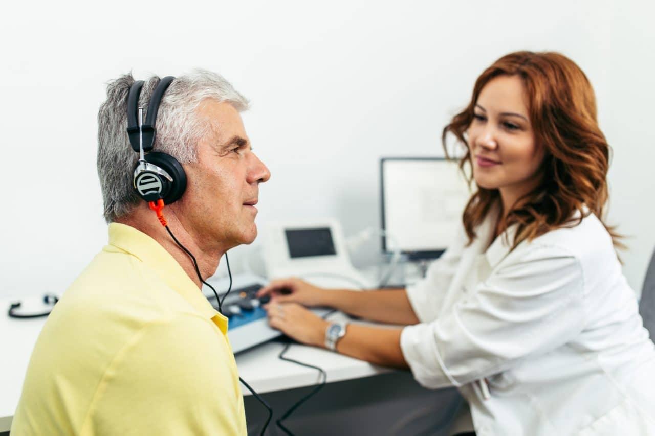 Older man gets a hearing test.